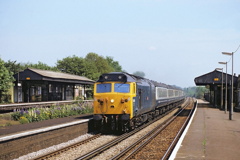 """18th May '82:  50019 """"Ramilies"""" on the 13.10 to Exeter races through Esher"""