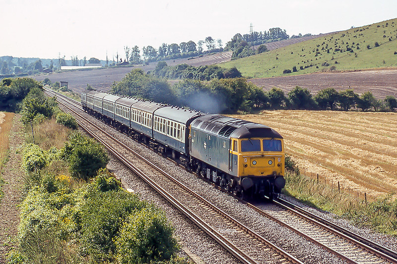 31st Aug 1982: Heading north away from Rowlands Castle is 47160 with the  11.05 Portsmouth to Manchester
