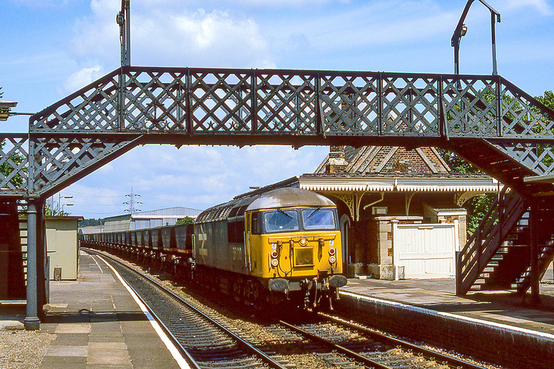 30th Jun 1982:  12.46 is not the ideal time to picture a train at this spot in Culham station  because the sun is in the wrong place but sometimes it is all that is available ,  56100 MGR coal train for the Didcot Power Station