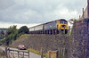 23rd Aug 1982:  The 08.29 from Leeds in the hands of 47558 is about to run through Upway &  Broadway station as it nears Weymouth.  It is a rather poorly framed grab shot as I walked back to my car.  Astra ULA 494X.  If I had known that it was coming I would have included the bottom of the gates and taken it a fraction earlier..  The road is actually quite steep and I was standing on the allignment of the Abotsbury Branch that curved away to the left and was equally steep.