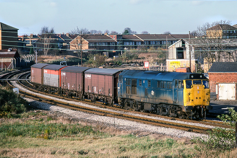 26th Nov 1982:  Rounding the curve at West Ealing is 31326 with four Railfreight vans in tow from Greenford