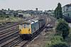2nd Sep 1982:  73105 is shunting four trucks full of domestic coal into the yard on the right beside Chichester station .