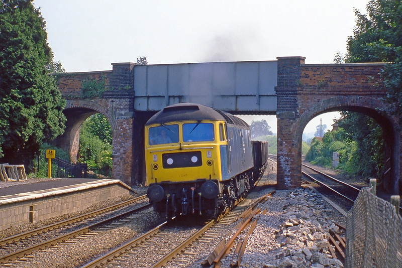 6th Jun 82:  47283 bursts through Aldermaston Station with stone empties for the Somerset quarries.  The bridge has recently been replaced in preparation for the instalation of overhead wires
