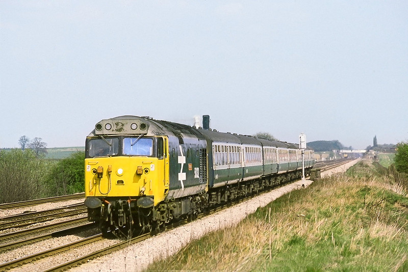 14th Apr 82:  With Milley Bridge in the background 50032 'Corageous' charges west on the 13.50 Paddington to Liverpool.  None of these linesiide locations at Ruscombe are now possible due to fencing and more importantly vegetation