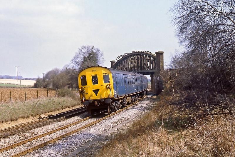 31st Mar 82:  Class 205 Thumper 1126 brings the 12.34 Basingstoke to Salisbury under the Flyover at Battledown