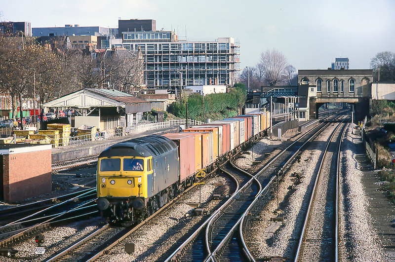 26th Nov 1982:  On the Down Relief at West Ealing is 47026 on a short Freightliner. The fenced off  siding behind the train was the West Ealing milk dock