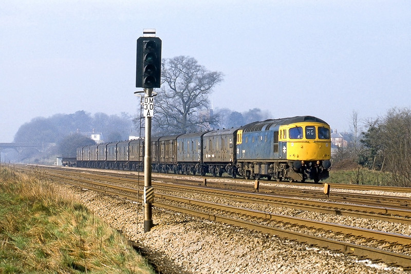 26tyh Mar 82:  33003 works a Parcels service towards London through Ruscombe