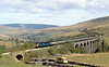 26th Apr 82:  The 06.55 from Glasgow to Nottingham headed by 47424 will shortly enter Blea Moor Tunnel.  Dent Station can just be seen on the far distant hillside..  I will never forget the first time that I drove over this road and saw this stunning vista.