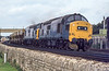 25th Aud 1982:  Passing though Oxford are 37187 & 27151 that are working ARC hoppers from. Wolverton to Tytherington