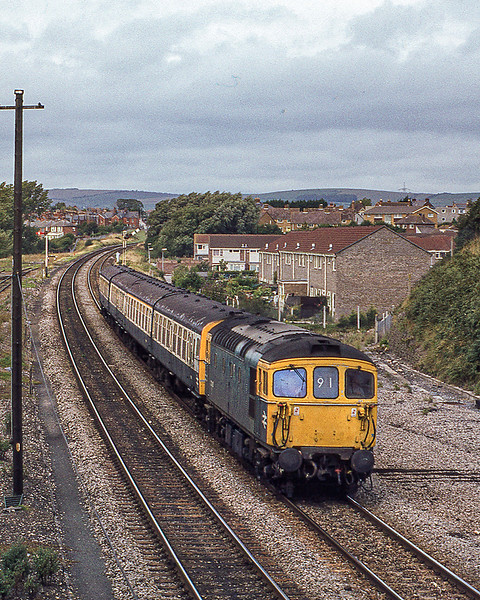 23rd Aug 1982:  Taken from the Alexandra foot bridge in Weymouth sees 33105 working the 11.35 from Waterloo to Weymouth..   The housing estate is on the site of the engine shed which I visited a number of times and where the team were always very friendly