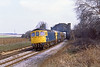 31st Mar 82:  33010+33027 westbound with ARC hoppers under Battledown Flyover