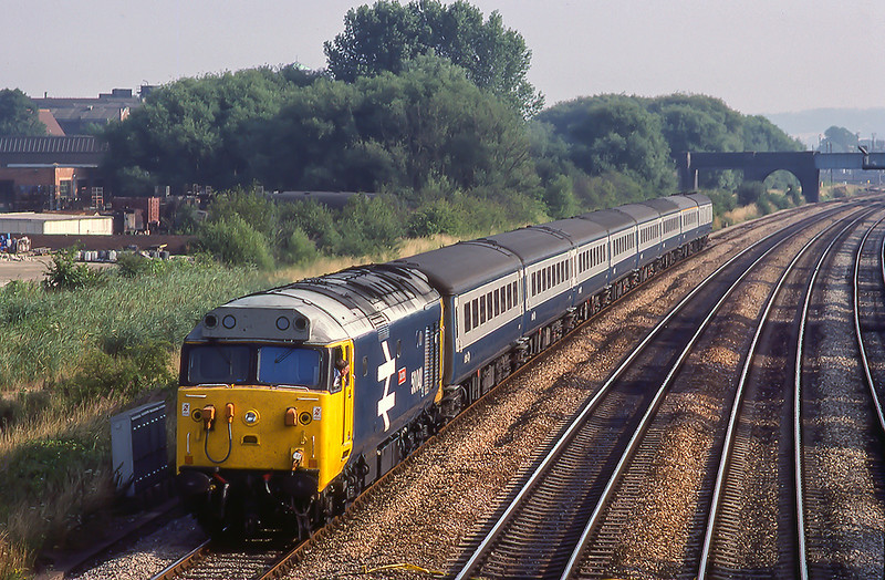11th Aug 1983:  59948 'Dauntless' is drawing forward with an ECS north of Oxford