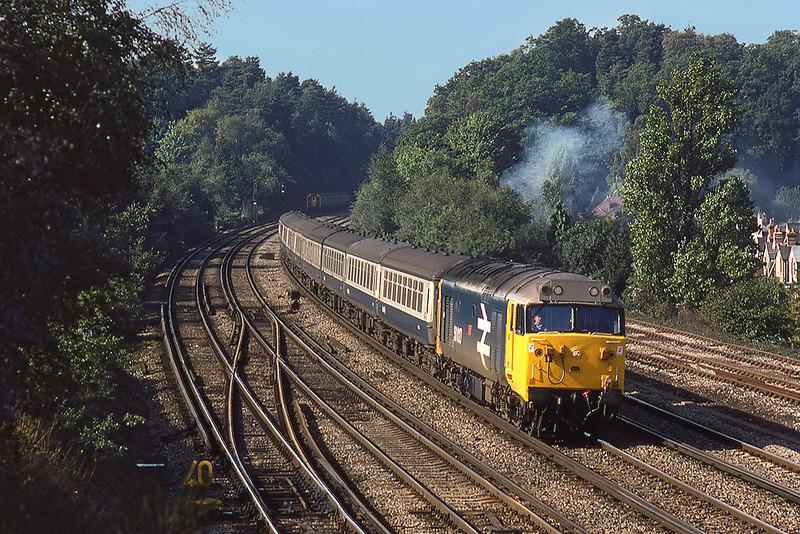 22nd Sep 1983: Arriving at Woking is 50027 'Lion' with the 06.48 Newton Abbot to Waterloo