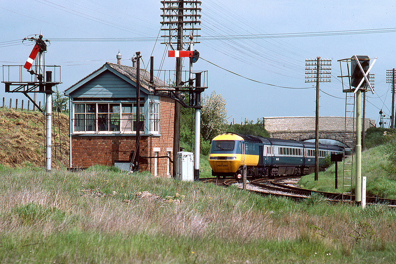8th May 83:  'The Cornish Riviera' the 10.25 from Paddington to Penzance hurries past Hawkeridge Junction.  It was diverted via Thingley Junction due to a derailment at Bedwyn