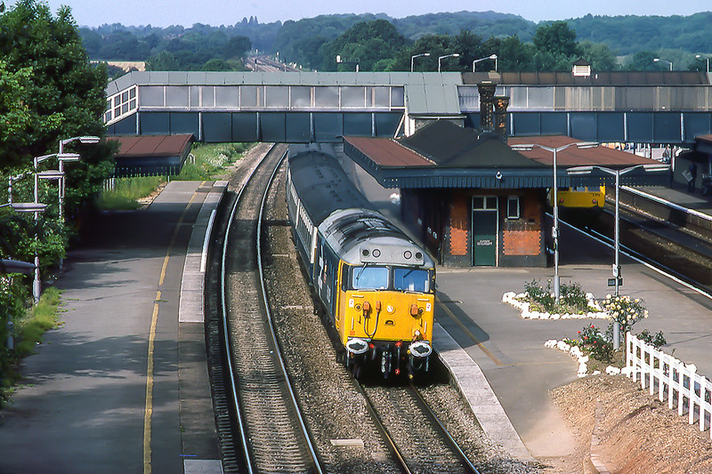 13th Jun 1983:   The 0644 from Westbury to Paddington in the hands of  50025 'Invincible'  is on the Up Main at Twyford.  This view illustrrates how the platforms were altered to ease the curve through the station to enable the HSTs to pass through at 125 mph..  Note how the canopy above the train has been cut back and on the Down line the canopy does not now cover the platform.