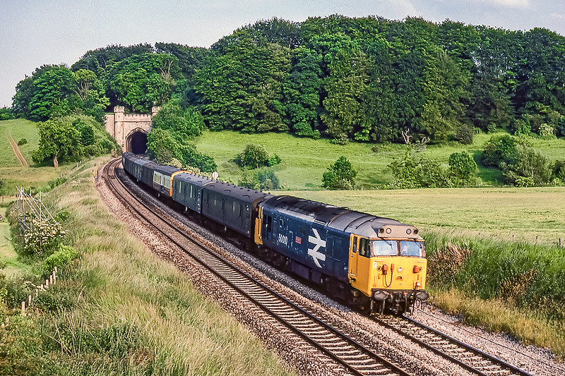 20th Jun 1983:  The 15.53 parcels service from Paddington to Swansea has just left Twerton Tunnels with 50010 'Monarch' providing the power.. Unfortunately  I did not know it was coming and was the wrong side of the light without the time to change