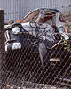 18th Aug 1983:  The wrecked truck that was used as a car transporter that failed when it tried  to squeeze through the  barriers on the Victory Road level crossing on the northern edge of  Egham