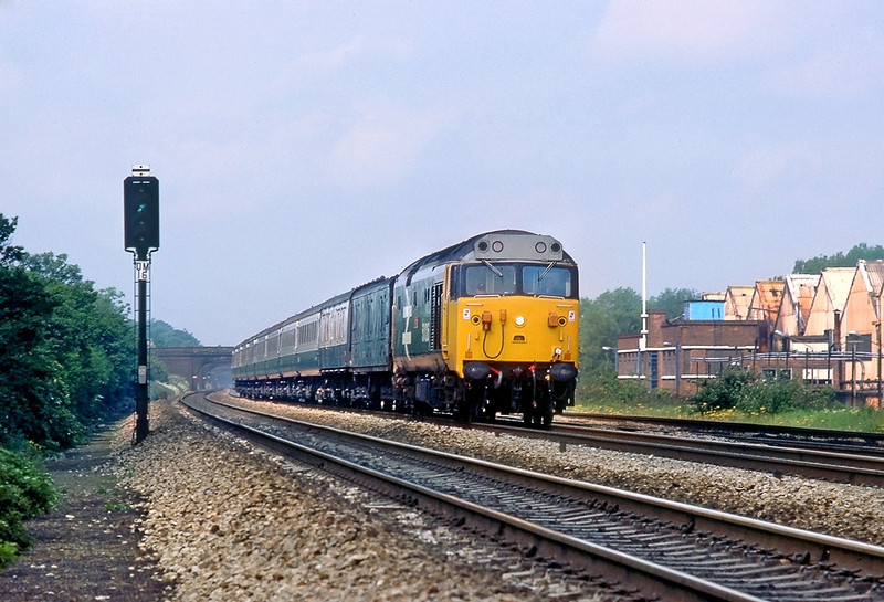 1st Jun 83:  the 08.22 from Cheltenham is in the hands of 50026 'Indomitable'.  Captured here on the Up Main at Langley