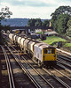 5th Oct 1983:  Passing through South Croydon is 73132 and a short rake of  empty BTRTT hoppers.  I have no idea where they were going.  The service had started on the 28th September 1983.