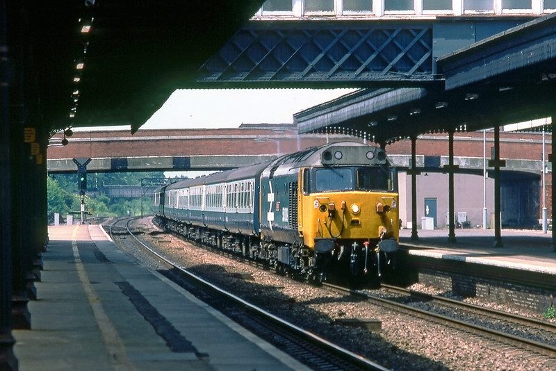 10th Jun 83:  50009 'Conquerer' on the 08.20 from Liverpool roars through Slough