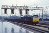 19th Apr '83:  On a very wet day 25326 plods through Preston with a load of spent ballast