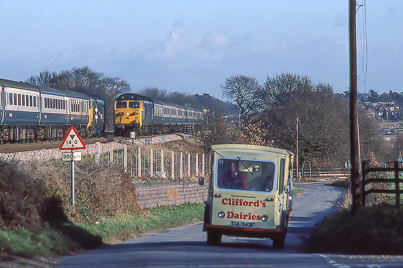 30th Dec 1983:  The way it was !!  50032 'Corageous' on the 11.15 Oxford Paddington, 50013 'Agincourt: on the 11.15 Paddington Oxford and an electric milk delivery van on Waingels Road near Twyford
