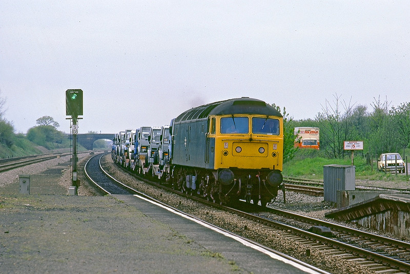 4th May 83:  With the rain now starting to fall (look at the signal)  47055 runs through Iver with Ford trucks from The Lanley Plant for delivery to Daggenham.