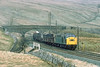 18th Apr 83:  Nearly at the top of the climb to Ais Gill is 40181 on a mixed freight for the South.  Probably Healey Mills yard