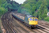 11th May 83: 33026 heads the 08.06 from Salisbury. Captured leaving St John's Cutting in Woking