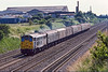 15th Jun 1983:  Pictured from the Breadcroft Lane bridge as it nears Maidenhead is 31151 with the 12.22 Swansea  Paddington Parcels.  The big factory was in the north west corner of White Waltham airfield.
