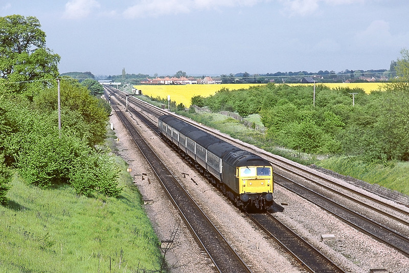 11th May 83:  The 15.00 from Brighton to Manchester is pictured from Southbury Lane in Ruscombe.  The grunt is being provided by 47107