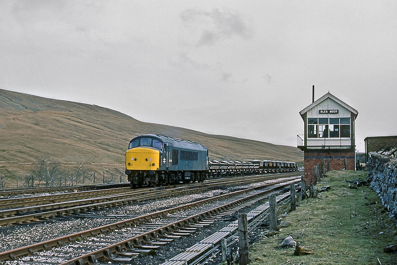 18th Apr83:  45040 runs round loaded ballast wagons from the Ribblehead quarry prior to heading south