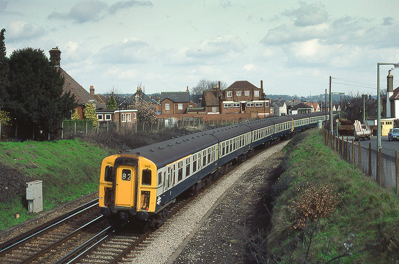 27th Mar 1983:  Running through Farncombe is 4 CIG (Class 421) 7412 with the 11.42 from Waterloo to Portsmouth