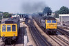 11th Aug 1983:  Laying a decent smoke screen over Oxford Station is 47377 with  Loaded MGR train for the Didcot Power Station