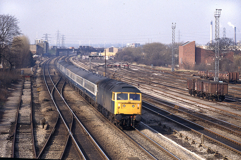 17th Feb 1983:  47419 at Slough West with the 07.30 from Manchester to Brighton.  The disused track on the left is the now reduntant  West Junction exit from the line from Windsor