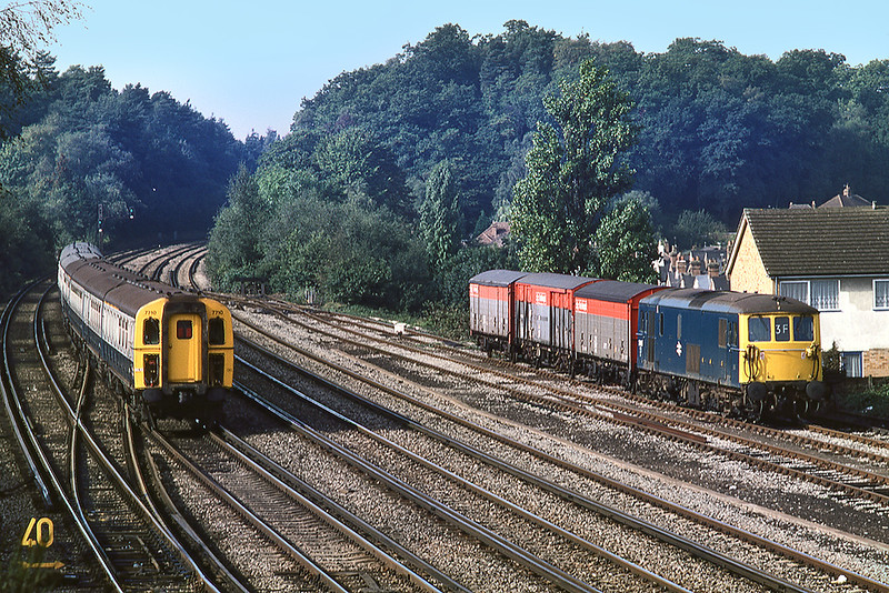 22nd Sep 1983:  A pair of 421s with 7310 head west from Woking as 73108 enters the loops with the Eastleigh Clapham vans.