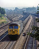11th Aug 1983:  At 15.45 approching Oxford with a loaded MGR train to the Didcot Power Station is 56065. passing Ground Signal 'OX69.'