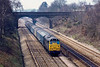 17th Mar 1983: Pictured from the Southbury Lane bridge in Ruscombe is 31273 with an empty news paper van train. passing under the Stanlake Lane bridge.  Just visible in the distance on the Up Relief is the platform at Twyford