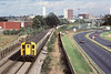 11th Oct '83:  7744 leaves Bracknell shortly after the A329 was opened and before the trees and lamp posts grew!