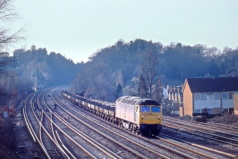 17th Jan 83:  47354 trundles into Woking with a load of empt Grampus Ballast wagons