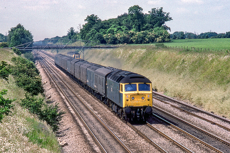 28th June 1983: A traffic that is no more is the conveyance of news papers.    At Shottesbrooke. 47186 is returning the empty vans to Paddington from Carmarthen.