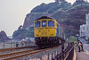 9th Aug 1983:  The  15.45 from Paignton to Exeter with 33026 in the point exits the Kennaway Tunnel at Dawlish.