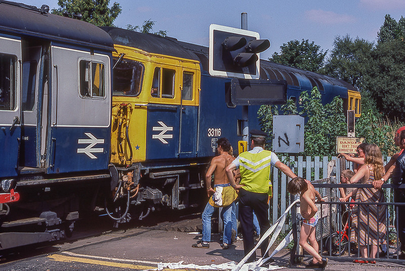 18th Aug 1983:  33116 is preparing to pull the 2 EPB back from the wreckage of the lorry and hopefully open the road again