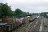 13th Jun 84:  33113 and 4 VEP 7792 on the 10.29 Brighton to  Victoria cross at Redhill