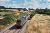 1st Aug 1984:  Running through Froxfield at 10.48 with empty Yeoman hoppers from Theale to the Somerset Quarries is 56048..