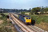 6th Sep 1984:   About to pass under the  Gitchell Lane  bridge in Rosevidney is 47511 'Tamar'. It is working the 15.00 from Plymouth to Penzance.