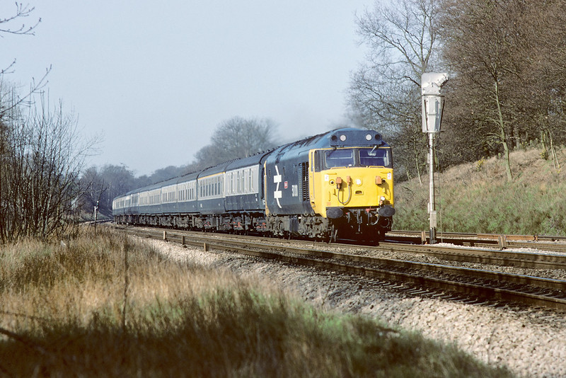 16th Apr 84:  The 6.25 from Taunton in the hands of 50010 exits the Sonning Cutting and will shortly pass the Twyford Station.  Regrettably this pleasant view is no long possible.