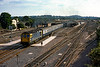 12th Sep 1984:  The 13.15  from Portsmouth Harbour to Bristol Temple Meads is geting away from Westbury's platform 2  powered by 33104.  The view from this spot is no longer available due to trees  but if it were you would not bother.