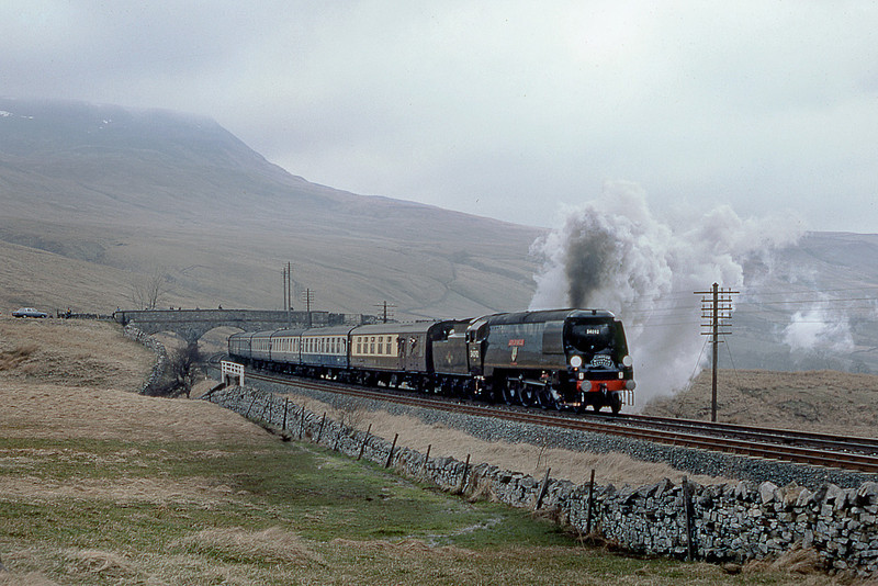 """14th April 84:  As it was running very late the gallery had waited many hours on a bitterly cold day for 34092 """"City of Wells"""" at Ais Gill on the southbound """"Cumbrian Mountain Express"""" on the 14th April 1984."""