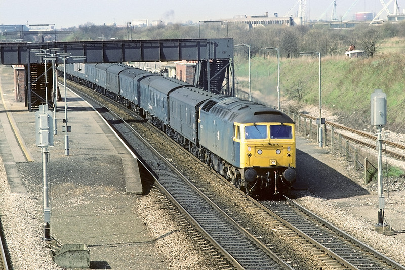 4th Apr 84: 47137 is captured here on the Relief at Iver with the returning newspapaer vans from Plymouth